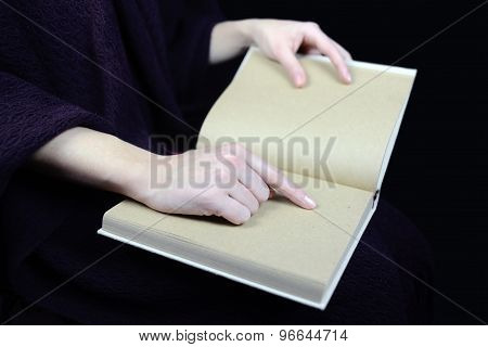female hands holding an open book