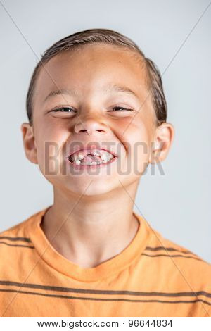 Child showing missing baby teeth.
