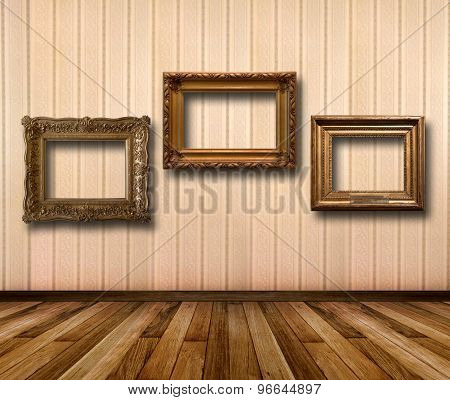 Interior Of Room With Striped Wallpaper And Gold Wooden Frames