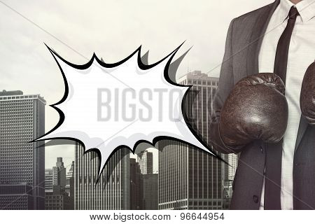 Empty speech bubble with businessman wearing boxing gloves