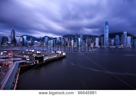skyline and  buildings in harbor of hong kong