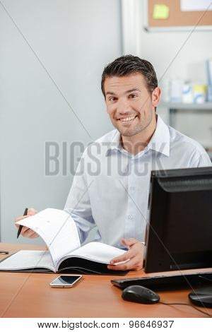 Businessman writing in his diary