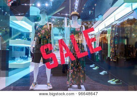 sale word on shopfront display window