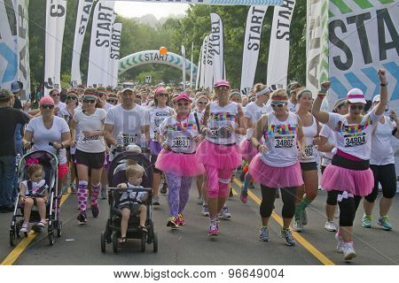 Enthusiastic Color Runners Take Off