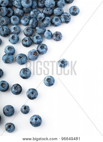 Fresh blueberries sprinkled. Isolated on white background