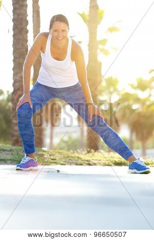 Smiling Older Woman Stretching Muscles