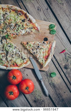 Vegetarian Italian Pizza On Wodden Table. Retro ,vintage Filter.