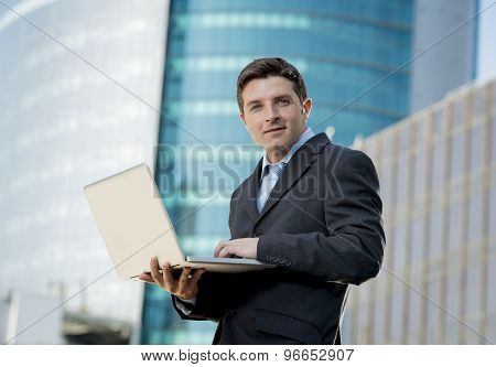 Businessman Holding Computer Laptop Working Outdoors