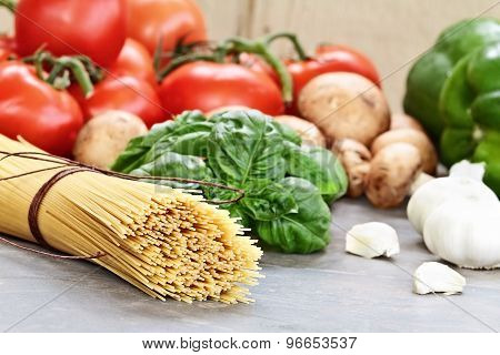Uncooked Spaghetti And Ingredients For Sauce