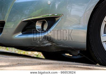 Silver Car Damage At Front Skirt
