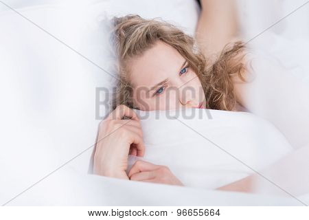 Frustrated Female Lying In Bed