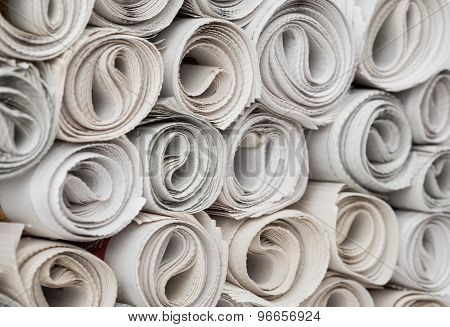 Rolls of newspapers.