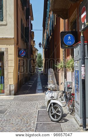 VERONA, ITALY - JULY 11: Narrow alley in Verona with scooter parked. July 11, 2015 in Verona.