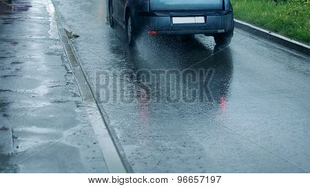 Rain, Autumn Street Background - Car Rides On The Road, Puddle And Splashing Water In Rainy Day