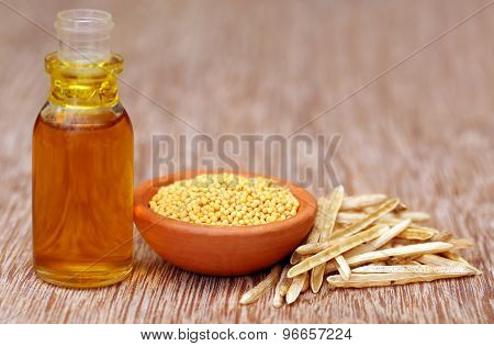 Golden Mustard With Empty Pods And Oil In A Bottle
