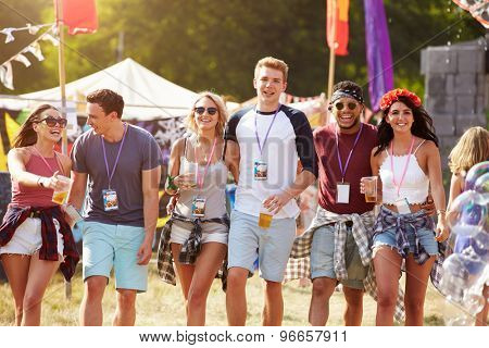 Group of friends walking through a music festival site