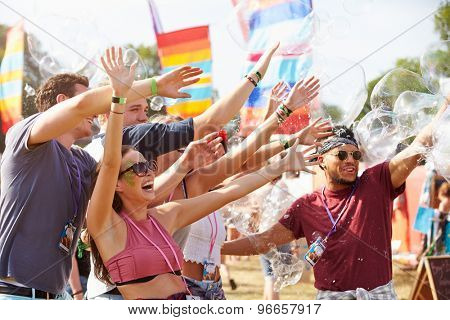 Friends enjoying a performance at a music festival