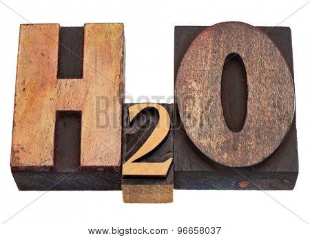 H2O - water chemical symbol in vintage wood letterpress printing blocks, stained by color inks, isolated on white