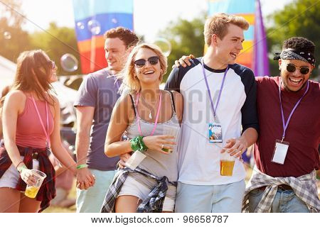 Friends friends walking through a music festival site