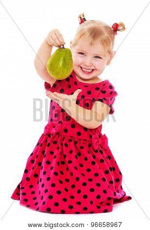 Little girl holding a pear