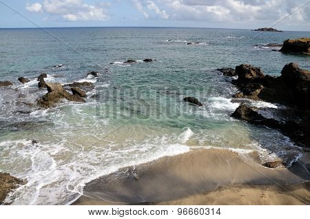 Foamy Wave On White Sand Beach