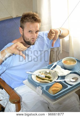 Man In Hospital Room Eating Healthy Diet Clinic Food In Upset Moody Face Expression