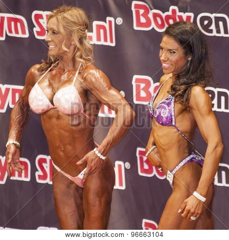 Female bikini models showing their best at a Championship Bodybuilding and Fitness