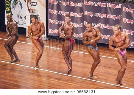 Male bodybuilders showing their best in a lineup