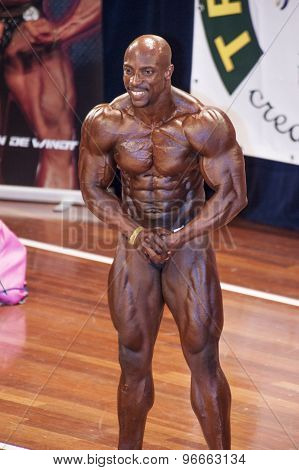 Male bodybuilder showing his best chest pose