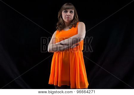 Image of pudgy woman with arms crossed