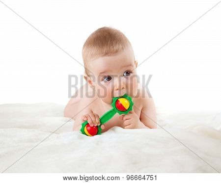 Baby holding a toy