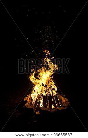 Photo of big bright campfire by night