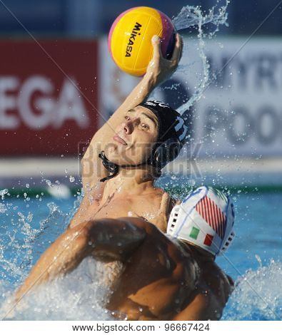 BARCELONA - JULY, 22: Alexandru Ghiban of Romania in action against Italy during a World Championship BCN2013 at the Picornell Swimming pool on July 22, 2013 in Barcelona Spain