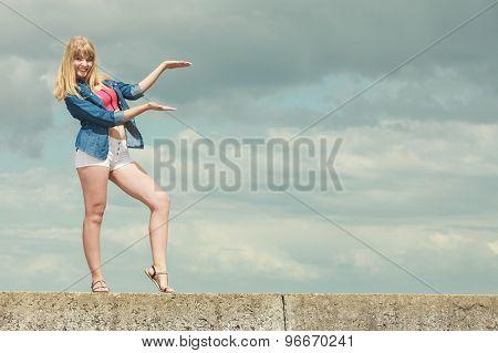 Summer Girl Showing Open Hand Against Sky