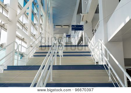 ADLER, RUSSIA - JULY 29, 2014: wide white and blue staircase in  Iceberg Skating Palace