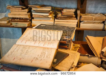 Antique Old Aged Books stacked on a wooden surface