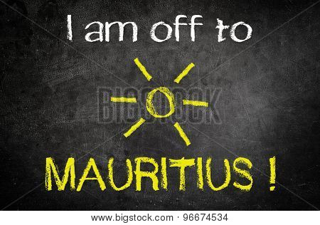 I am Off to Mauritus Message for Holiday Concept Written on a Black Vintage Chalkboard with Glowing Sun Drawing in the Middle of the Texts.