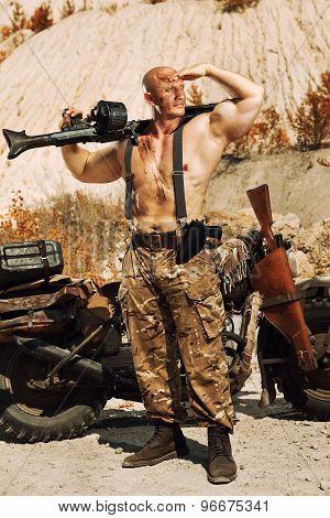 Powerful Soldier With The Machine Gun. Desert Background.