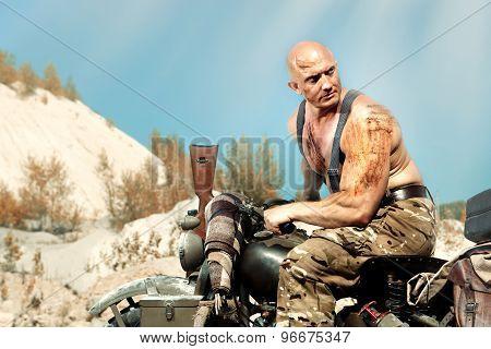 Muscular Bald Biker On The Autumn Background