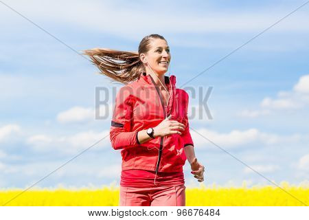 Woman running for better fitness in spring