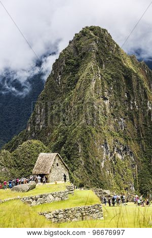People Climb Up The Wayna Piccu Next To Machu Picchu In Peru