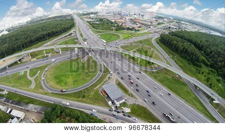 Cityscape with traffic on Novorizhskaja overpass at summer cloudy day. Aerial view. Photo with noise from action camera.