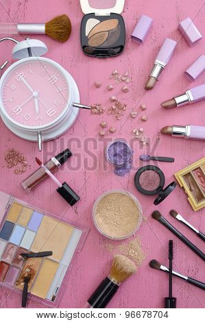 Makeup Items On Vintage Pink Wood Table