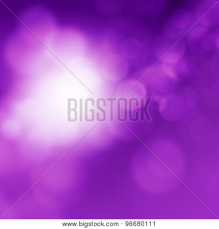Abstract blurred purple background with bokeh lights