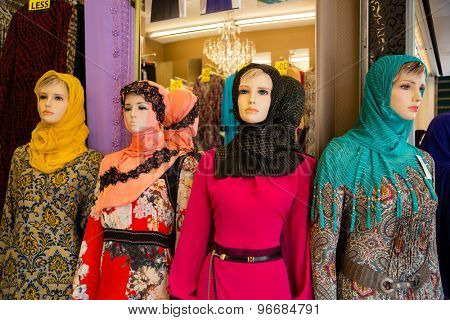 SINGAPORE - CIRCA FEBRUARY, 2015: Mannequins in shop window in Arab quarter (Kampong Glam). Arab Quarter is the oldest historic shopping district of Singapore, is popular for visiting tourists.