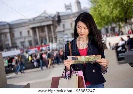 chinese tourist reading a map