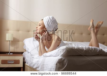 Image of sensual woman resting after taking bath