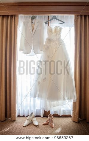 The Wedding Dress Hanging At The Window