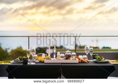 Empty Glasses Set In Restaurant - Dinner Table Outdoors At Sunset.