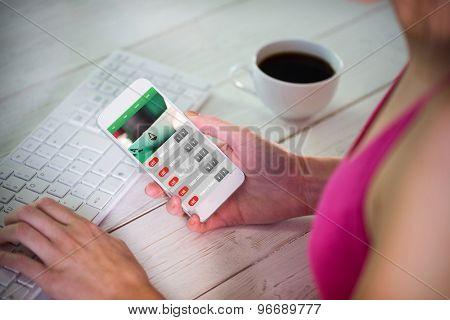 Woman using her smartphone against gambling app screen